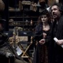 "Actors Timothy Spall (left) and Helena Bonham Carter (middle) with Director Tim Burton (right) on the set of ""Sweeney Todd: The Demon Barber of Fleet Street"" Photo Credit: Leah Gallo. © 2007 by DreamWorks LLC and Warner Bros. Entertainment Inc"