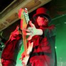 Mick Mars of Motley Crue performs at the Hard Rock Cafe September 18, 2006 in New York City - 396 x 594