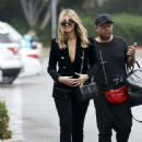 Delta Goodrem – Arriving on Extra! in Los Angeles - 454 x 642
