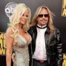 Vince Neil and Lia at the 2008 American Music Awards, Nokia Theatre, Los Angeles, CA