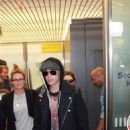Lily Collins and Jamie Campbell Bower arriving in Berlin (August 20)