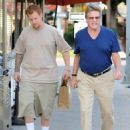 Ryan O'Neal and his son Redmond seen leaving a restaurant after lunch in Brentwood, California on December 27, 2013 - 454 x 576