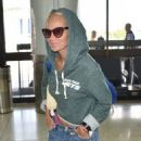 Kristin Chenoweth departing on a flight at LAX airport in Los Angeles, California on September 4, 2015
