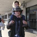 Orlando Bloom and his son Flynn arriving on a flight at LAX airport in Los Angeles, California on February 19, 2014