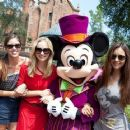 Nina Dobrev with Candice Accola, Kayla Ewell and Mickey Mouse in front of The Haunted Mansion (September 1)