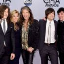Reid and Kimberly Perry of The Band Perry, Steven Tyler, Neil Perry of The Band Perry, and Scott Borchetta attend the 48th annual CMA Awards at the Bridgestone Arena on November 5, 2014 in Nashville, Tennessee. - 454 x 290