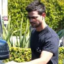 Taylor Lautner and his girlfriend  were seen leaving Fred Segal in West Hollywood, California on March 23, 2017 - 443 x 600