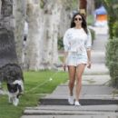 Nina Dobrev – Takes her dog for a walk in Los Angeles