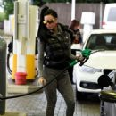 Jemma Lucy in Tights at a gas station in London - 454 x 607