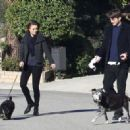 Ashton Kutcher and his girlfriend Mila Kunis take their dogs for a morning walk on January 13, 2014 in Los Angeles, California