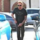Johnny Hallyday is seen visiting the Brentwood Country Mart with his wife Laeticia on February 2, 2015 in Brentwood, California - 454 x 593