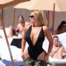 Anastasia Kvitko in Black Swimsuit at the beach in Miami