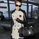 Emma Watson - At Heathrow airport in London - November 14, 2010