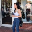 Aimee Garcia in a white tank top and denim jeans at Fred Segal in West Hollywood - 454 x 621