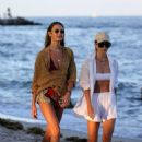 Candice Swanepoel – Stroll on the beach with a friend in Miami