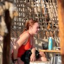 Lindsay Lohan – In red swimsuit on Mykonos Island - 454 x 680
