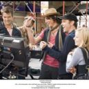 BTS: JOSH DUHAMEL, DAX SHEPARD (obscured), WILL ARNETT, MARK STEVEN JOHNSON, KRISTEN BELL. Photo: Myles Aronowitz SMPSP. '© Touchstone Pictures, Inc. All Rights Reserved.' - 454 x 345