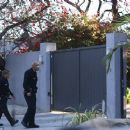 Miley Cyrus was greeted by police officers at her home in Studio City, on Saturday, February 1, 2014
