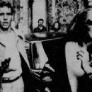 Ryan O'Neal and Ursula Andress - 454 x 334
