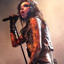 Andy Sixx is performing