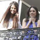 Selena Gomez, Vanessa Hudgens, Rachel Korine, and Ashley Benson waving to their fans from their balcony at Bristol hotel in Paris, France, on February 17th 2013 - 454 x 533