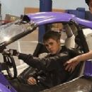 "Justin Bieber Returning to ""Fantasy Factory"" with Purple Car on April 4, 2011"
