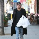 Evan Ross stops to pick up some lunch to go in Sherman Oaks, California on December 19, 2014 - 448 x 594