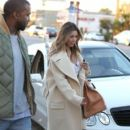 Kim Kardashian and Kanye West out doing some shopping at a sporting goods store in Los Angeles, California on December 26, 2013