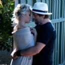 Pamela Anderson was seen kissing husband Rick Salomon on Wednesday July 16, 2014 in Malibu, just 1 week after it was announced she had filed for divorce