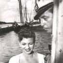 Robert Mitchum and Rita Hayworth