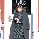 Miranda Kerr – Grabs coffee with a friend in Brentwood