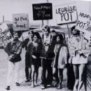 Robert Plant, leader of the 'Midlands Flower People' protesting outside a court, 1967. Shirley Wilson is on his left