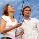 Dylan Neal and Lucy Lawless