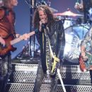 Aerosmith and Post Malone perform onstage during the 2018 MTV Video Music Awards at Radio City Music Hall on August 20, 2018 in New York City - 428 x 600