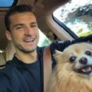 Grigor Dimitrov with Sharapova's dog in December 2014