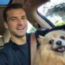 Grigor Dimitrov with Sharapova's dog in December 2014