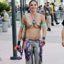 Adrianne Curry seen wearing a very revealing costume while out and about at Comic-Con in San Diego