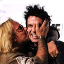 Motley Crue band members (L-R) Vince Neil and Tommy Lee arrive at the Annual Sunset Strip Music Festival, Tribute to Motley Crue at the House of Blues Sunset Blvd on August 18, 2011 in West Hollywood, California