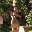 'Scary Movie 5' actress Ashley Tisdale returning home with a friend after grocery shopping at Trader Joe's in Toluca Lake, California on August 30, 2014
