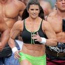 Danica Patrick displays bulky frame to film Super Bowl commercial..... but it's just a muscle suit - 454 x 600