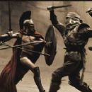 "Leonidas (GERARD BUTLER) fights his way through the first wave of Persian infantry in Warner Bros. Pictures', Legendary Pictures' and Virtual Studios' action drama ""300,"" distributed by Warner Bros. Pictures. Photo courtesy o"