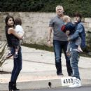 Justin Bieber and Selena Gomez spotted out holding some children in Malibu, CA on February 18, 2012