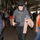 Serinda Swan – Arriving at LAX Airport in Los Angeles