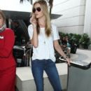Rosie Huntington-Whiteley arriving on a flight at LAX airport in Los Angeles, California on December 14, 2014