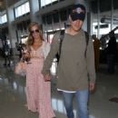 Paris Hilton and Chris Zylka at LAX Airport in Los Angeles - 454 x 625