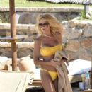 Victoria Silvstedt in Yellow Bikini at the beach in Sardinia - 454 x 682