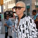 Amber Rose spotted posing for fans as she stepped out of her hotel in New York, New York on April 6, 2012