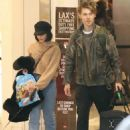 Vanessa Hudgens and Austin Butler at LAX Airport in LA - 454 x 581