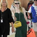 Dakota Fanning in Green Dress – Leaves from the airport in Venice