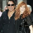 Bruce Springsteen and Patti Scialfa - 232 x 411